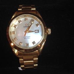 Omega Seamaster mid-size Ladies Watch in 18 carat Gold