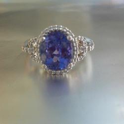Tanzanite Ring Set In Platinum With A Diamond Surround