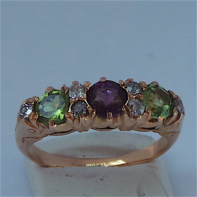 Lovely 5 stone Suffragette Ring with 2 peridots, 1 amethyst and 6 diamonds