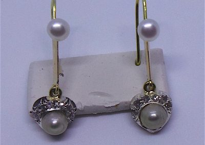 A pair of pretty pearl and diamond earrings