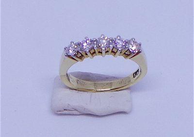 Pretty 5 stone half eternity ring in 18 carat gold