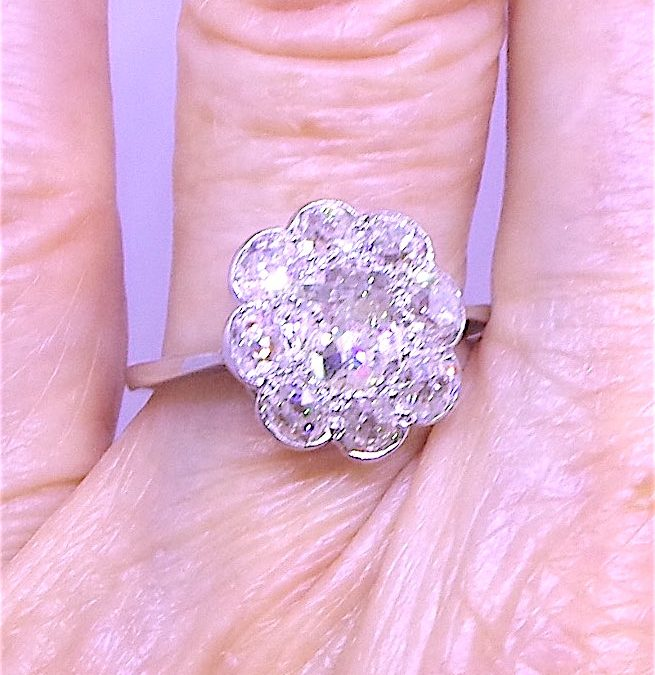 Beautiful Daisy Cluster Engagement ring in Platinum