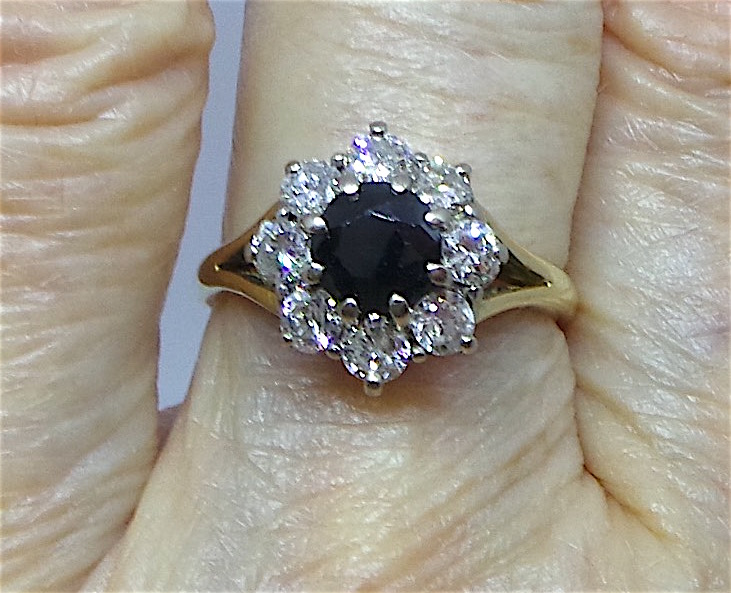 Pretty sapphire and diamond cluster ring