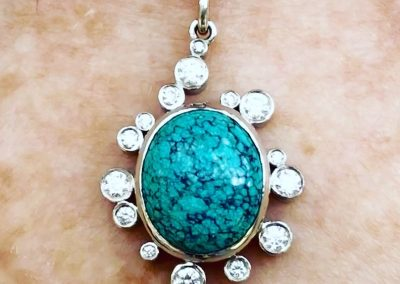 Unusual Turquoise matrix and diamond pendant in platinum