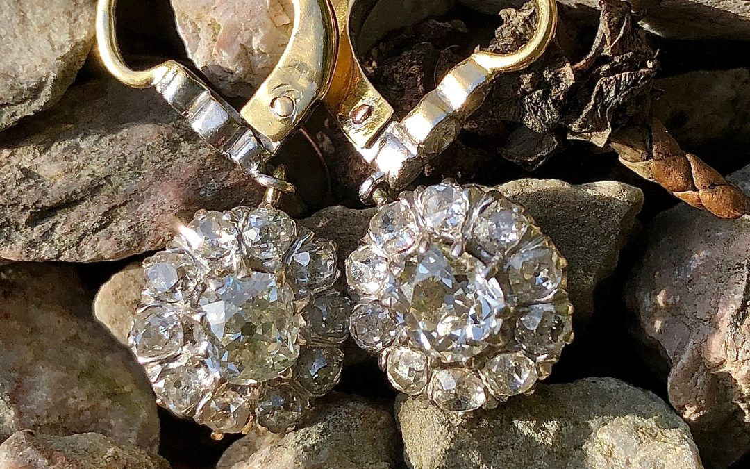 Feminine and flattering drop cluster diamond earrings in 14 carat gold