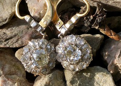 Feminine and flattering drop cluster diamond earrings in 14 carat gold